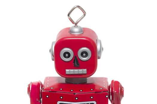 Vintage retro red tin toy robot isolated on a white background.