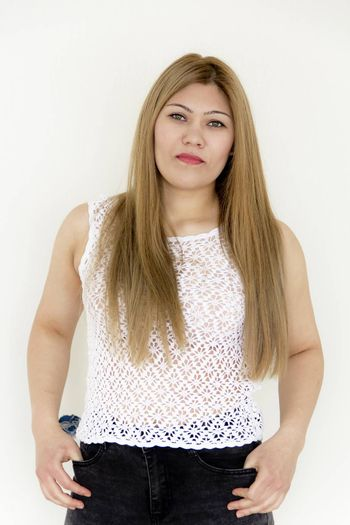 Attractive young girl with long brown healthy straight hair in white