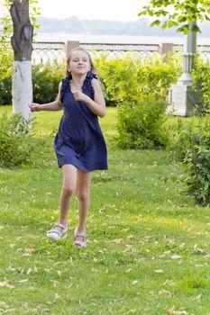 Vertical photo of cute running European girl with disheveled hair