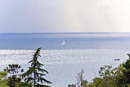 Calm breeze sea and white vessel in summer sunny day