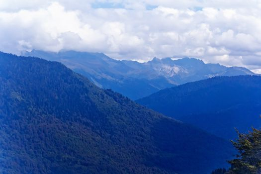 Blue Russian Caucasus mountains landscape with cloudy sky