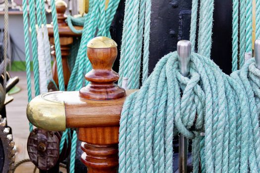 Thick green rope on board of ocean vessel