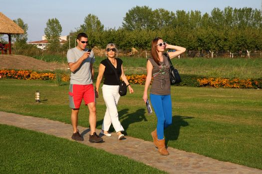 Young man and two women walking outside
