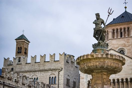Main square Piazza Duomo, with clock tower and the Late Baroque Fountain of Neptune. City in Trento Italy