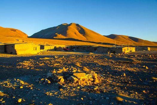 Evening landscape and accomodation buldings at Laguna Colorada, Altiplano area, Bolivia, South America
