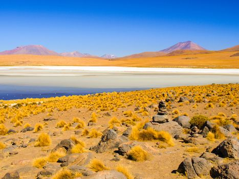 Desolate desert and mountainous landscape of southern Altiplano with lagoon, Andes, Bolivia