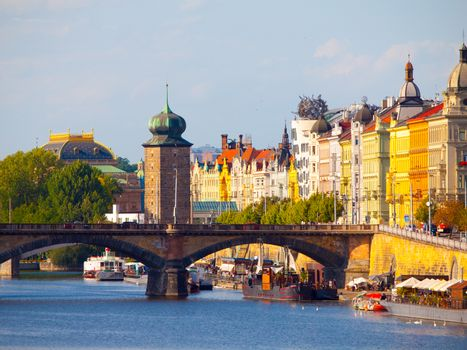 Masaryk Embankment with and Sitkovska water tower Palacky Bridge over Vltava River in Prague city centre, Czech Republic