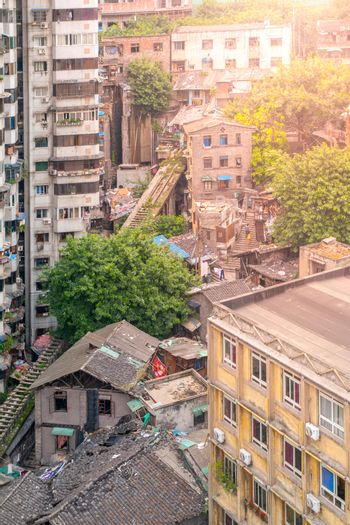 Aerial view of dirty city slum with old unfunctional ground cable car way in Chongqing, China
