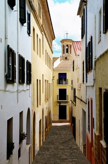 Old Narrow Street with Colorful Houses in Mahon, Menorca, Balearic Islands, Spain