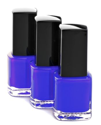 Three Shades of Purple Bright Nail Varnishes isolated on white background