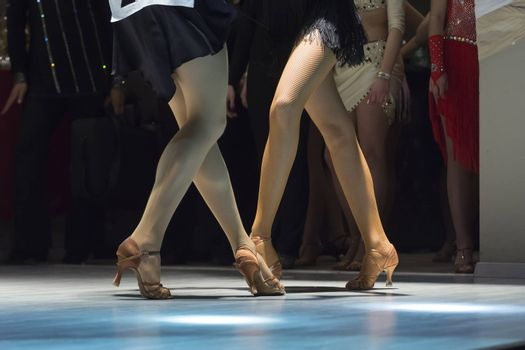 female legs of young girls who dance in competition