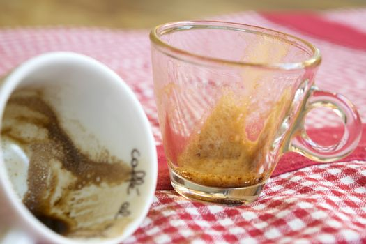 coffee grounds in two empty cups