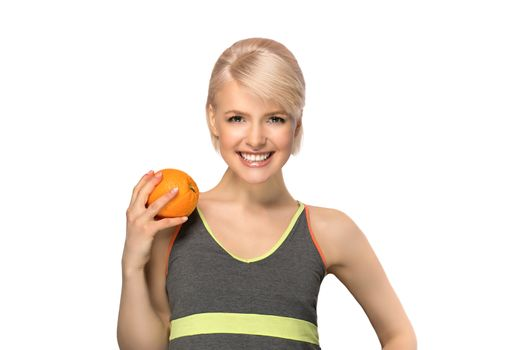 Happy smiling slim woman holding orange, studio portrait isolated on white background, healthy lifestyle concept