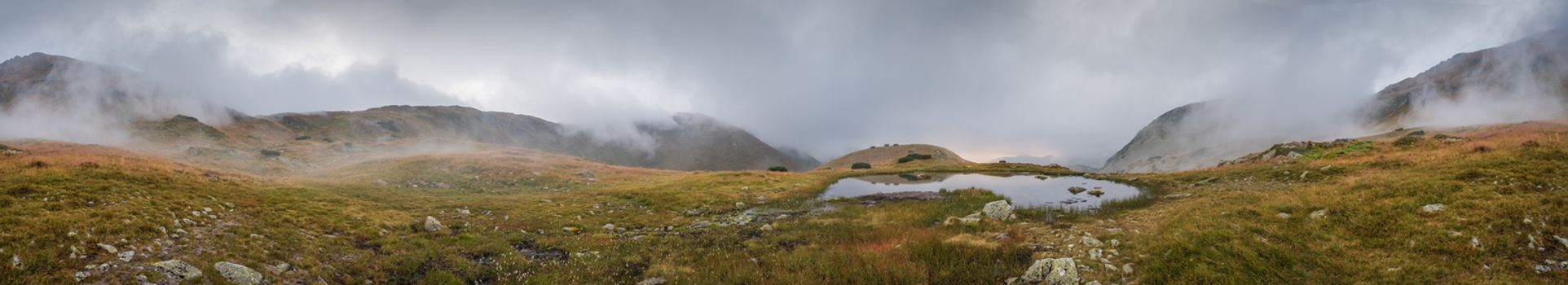 Small Tarn with Fog in Mountains at Sunset