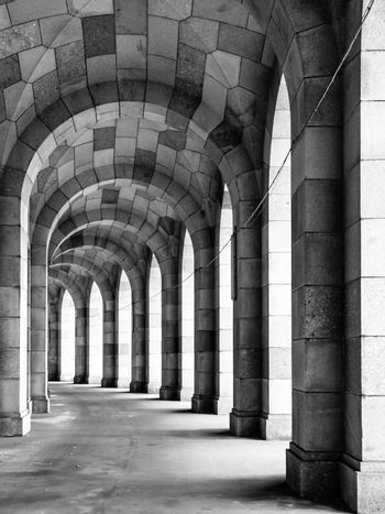 The arched stone colonnade