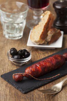 spanish chorizo sausage on black slate