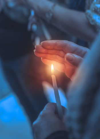 Believer in a church with candle