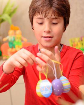 Cute boy preparing to Easter