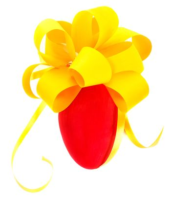 Closeup photo of beautiful red drawing egg with festive yellow bow isolated on white background, tradition symbol of Easter holiday