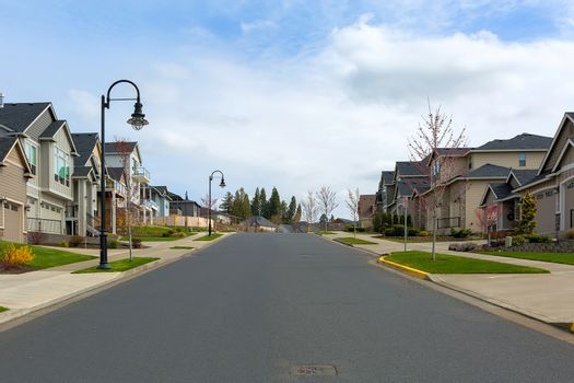 New North American suburban upscale neighborhood homes along street in Happy Valley Oregon United States