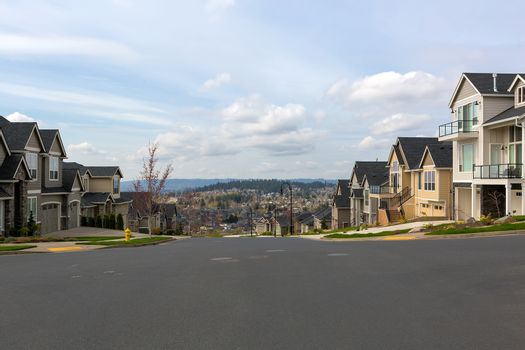 New North American suburban neighborhood upscale homes along street in Happy Valley Oregon United States