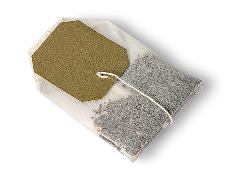 Single tea bag lying
