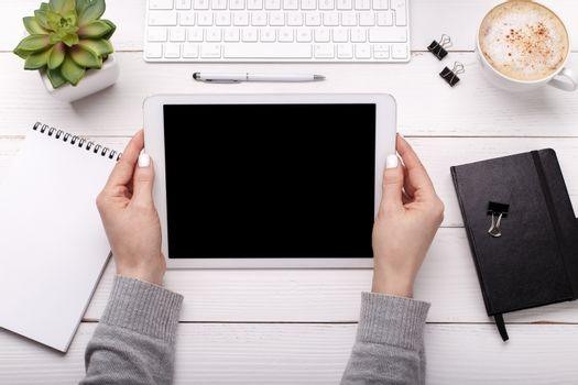 Female hands with tablet