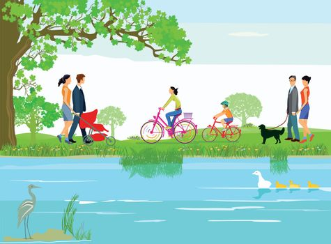 Families relax by the lake