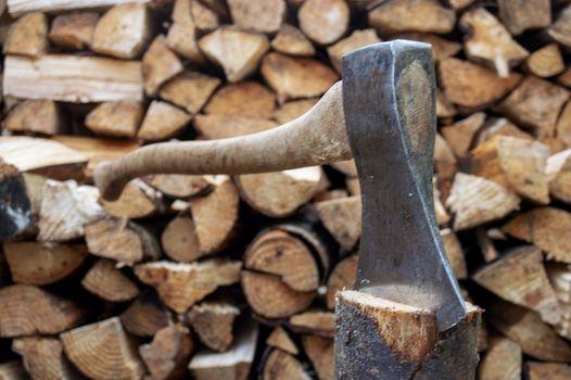 Vintage axe in in wood log in spring.