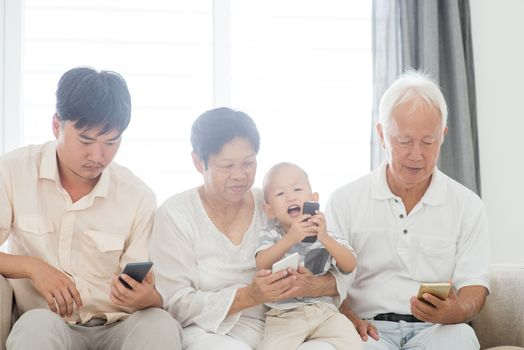 Technology devices, gadgets addicted family. Member family busy with their smart phone, communication problem.