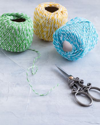 Colored cords with scissors, present wrapping and packing material