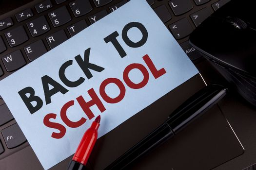Conceptual hand writing showing Back To School. Business photo showcasing Right time to purchase schoolbag, pen, book, stationary written Sticky Note Paper placed Laptop Marker Mouse