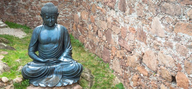 Meditating Buddha Statue, made of bronze. 19th Century, sitting stance, useful copyspace.