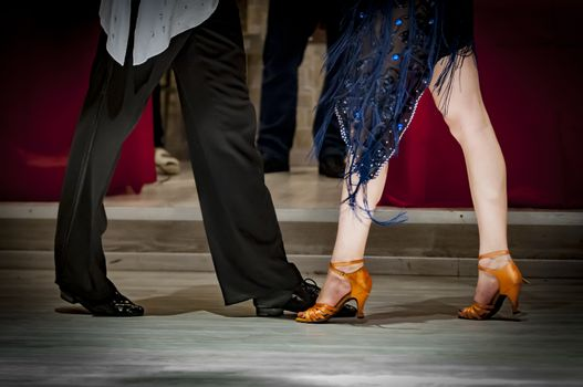 legs of a couple who dance in competition