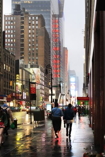 New York, USA - May 20, 2013: Time Square at night in the rain. The site is regarded as the world's most visited tourist attraction with nearly 40 million visitors annually.