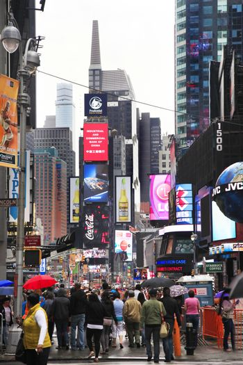 New York City, NY, USA - May 18, 2013: Times Square, featured with Broadway Theaters and huge number of LED signs, is a symbol of New York City and the United States, May 18, 2013 in Manhattan, New York City