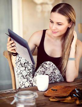 Woman having breakfast in a city cafe