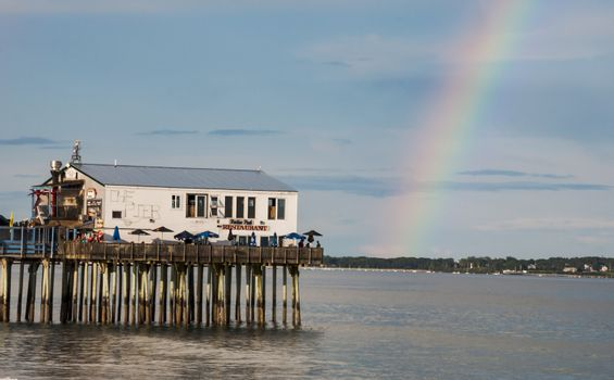 The pier and rainbow on Old Orchard Beach in Maine, Usa