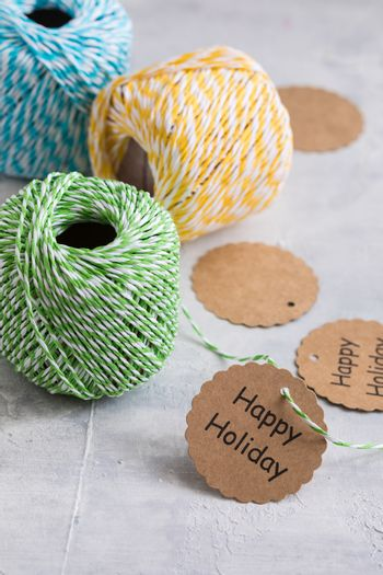 Colored cords, present wrapping and packing material