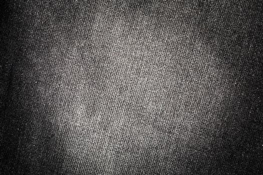 Texture of old black jeans for background
