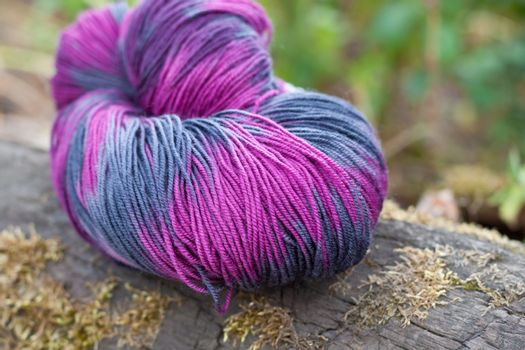 Colorful wool yarn on the rustic background