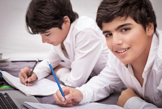 Two boys doing homework