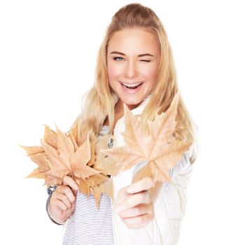Joyful girl with dry leaves