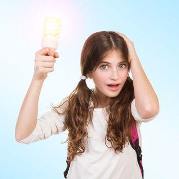 Shocked schoolgirl with lamp