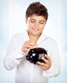 Teen boy with piggy bank