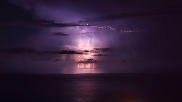 Purple lightning over the sea