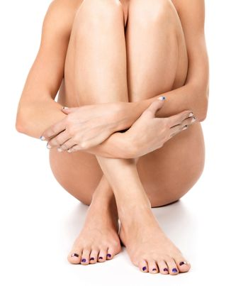 Well groomed female legs and hands, skincare concept, isolated on white background