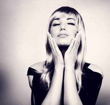 Portrait of a fashion model with closed eyes touching her face, black and white photo, gorgeous sensual look