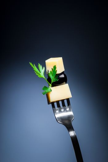 Cheese and olive on the fork