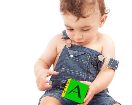 Little boy learning letters